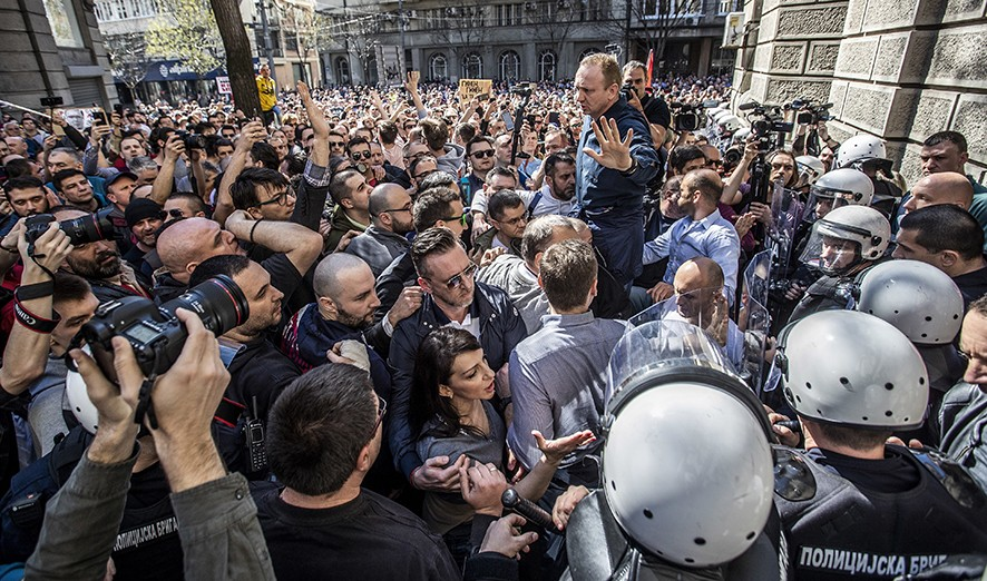 Opposition leader Dragan Djilas (C) talks in front of the office of the President of Serbia in Belgrade, Serbia, 17 March 2019. Thousands of people protested in Serbia against the President Aleksandar Vucic over what they say has been a smothering of democratic freedoms under his government. EPA/SRDJAN SUKI