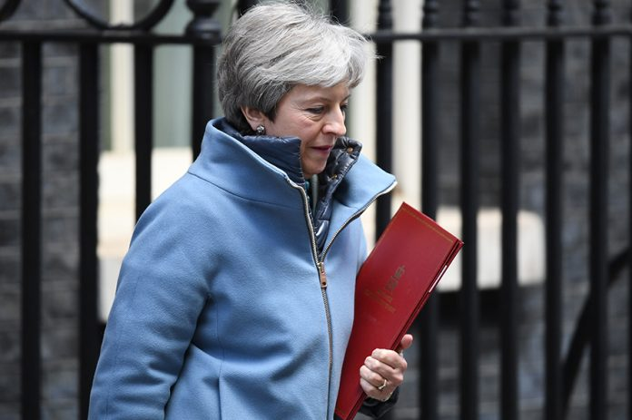 LONDON, ENGLAND - MARCH 25: British Prime Minister, Theresa May leaves Downing Street following a cabinet meeting on March 25, 2019 in London, England. British Prime Minister Theresa May is facing increased pressure resign as she continues her attempts to pass a Brexit deal through parliament. (Photo by Leon Neal/Getty Images)