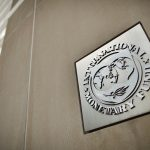 WASHINGTON, DC - MAY 16: A sign hangs on the The International Monetary Fund Headquarters 2 building on Pennsylvania Avenue just blocks from the White House May 16, 2011 in Washington, DC. IMF Managing Director Dominique Strauss-Kahn, a potential candidate for the French presidency, was detained May 14 on a departing airplane after he was accused of trying to rape a maid in a $3,000-a-night suite at a New York City hotel. (Photo by Chip Somodevilla/Getty Images)