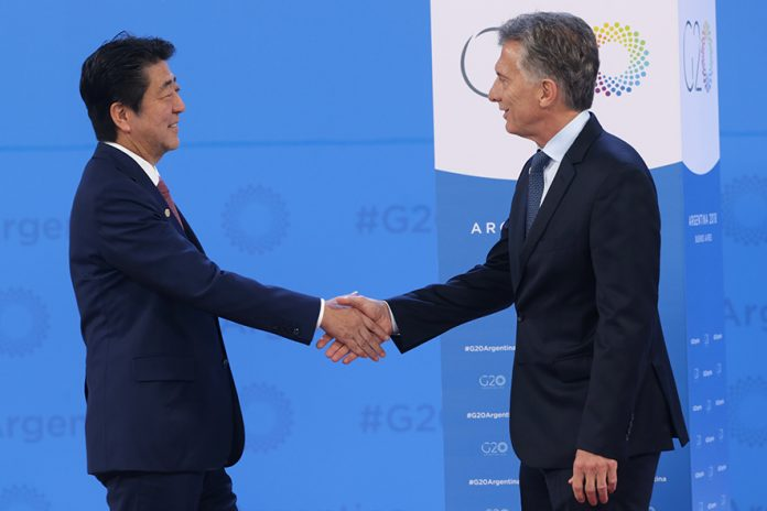 BUENOS AIRES, ARGENTINA - NOVEMBER 30: President of Argentina Mauricio Macri greets Prime Minister of Japan Shinzo Abe upon his arrival to the opening day of Argentina G20 Leaders' Summit 2018 at Costa Salguero on November 30, 2018 in Buenos Aires, Argentina. (Photo by Daniel Jayo/Getty Images)