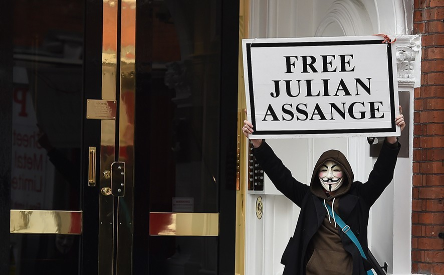 A Julian Assange supporter outside the Ecuadorian Embassy in south west London, Britain, 05 April 2019. Reports state that the Ecuadorian embassy plan to remove Wikileaks founder Julian Assange from the embassy within days. Assange claimed political asylum in the embassy in June 2012 after he was accused of rape and sexual assault against women in Sweden. EPA/ANDY RAIN
