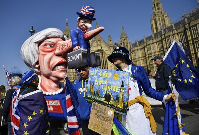 Brexit protesters demonstrate outside Parliament in London, Britain, 01 April 2019. British Members of Parliament are taking part later in the evening in indicative votes on alternative versions for Brexit with Prime Minister Theresa May's cabinet ministers again instructed to boycott the votes. EPA/NEIL HALL