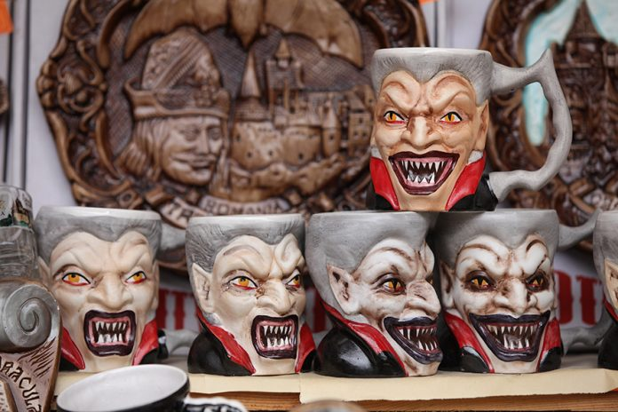 BRAN, ROMANIA - MARCH 10: Mugs bearing a rendition of Dracula are displayed at a souvenir shop at Bran Castle, famous as