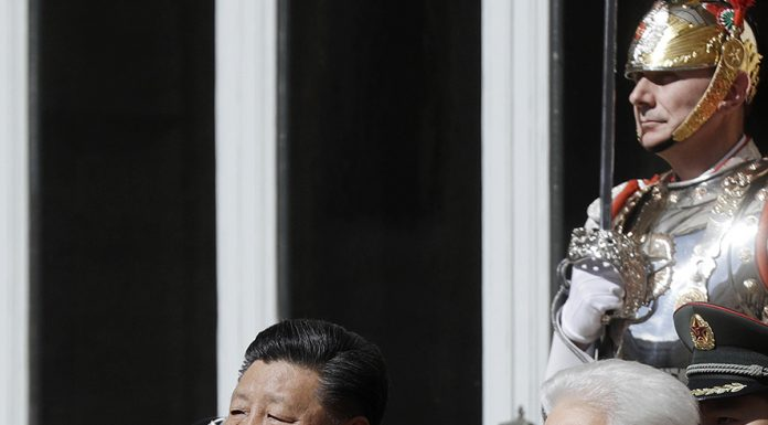 Chinese President Xi Jinping, left, Italian President Sergio Mattarella listen to the national anthems during a farewell ceremony at the Quirinale Presidential Palace, in Rome, Saturday, March 23, 2019. (AP Photo/Gregorio Borgia)