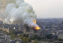 "In this image made available on Tuesday April 16, 2019 flames and smoke rise from the blaze at Notre Dame cathedral in Paris, Monday, April 15, 2019. An inferno that raged through Notre Dame Cathedral for more than 12 hours destroyed its spire and its roof but spared its twin medieval bell towers, and a frantic rescue effort saved the monument's ""most precious treasures,"" including the Crown of Thorns purportedly worn by Jesus, officials said Tuesday. (AP Photo/Cedric Herpson)"