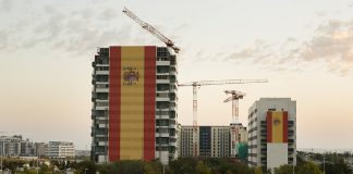 MADRID, SPAIN - OCTOBER 12: A huge Spanish flag of 731 meters square covers the facade of a building under construction in Valdebebas during Spain's National Day on October 12, 2017 in Madrid, Spain. Every October 12 Madrid celebrates Spain's National Day also called Hispanic Day with a military parade presided by Royal Family and the Spanish Prime Minister. This year the parade takes place as Spain faces a rise of tensions with Catalonia after the referendum vote for independence. (Photo by Pablo Blazquez Dominguez/Getty Images)