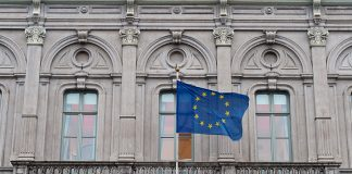 BRUSSELS, BELGIUM - FEBRUARY 25: The flag of the European Union flies from the European Parliament information office in the European Quarter on February 25, 2016 in Brussels, Belgium. Brussels is often referred to as the unofficial capital of Europe due to its concentration of pan-European institutions including the European Union (EU) and The Council Of Europe. The United Kingdom will hold a referendum on June 23 to decide whether they will remain part of the EU. (Photo by Ben Pruchnie/Getty Images)
