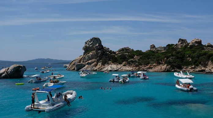 PALAU, ITALY - JULY 28: Boats float in turquoise water at Spiaggia di Cala Corsara beach on Isoli Sparggi island on July 28, 2018 near the island of Sardinia and Palau, Italy. Sardinia is a popular summer tourist destination. (Photo by Sean Gallup/Getty Images)