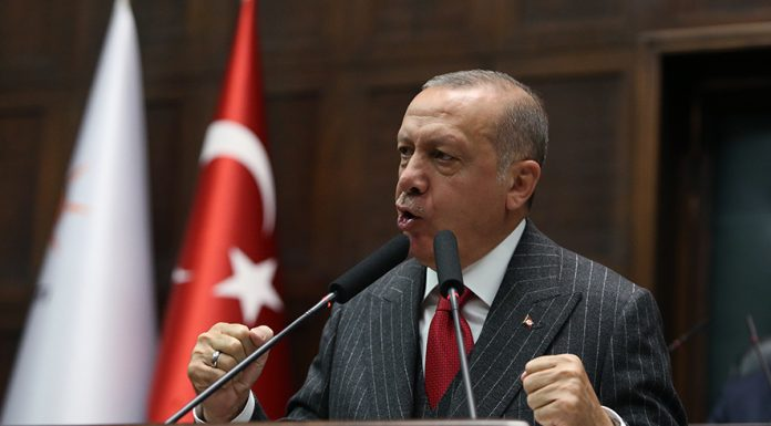 """Turkish President Recep Tayyip Erdogan addresses members of ruling Justice and Development Party (AKP) at their group meeting at the parliament in Ankara, Turkey, 07 May 2019. According to reports, the Turkish Electoral Commission has ordered a repeat of the mayoral election in Istanbul as President Recep Tayyip Erdogan's AK Party had alleged there was """"corruption"""" behind his party losing. EPA/STR"""