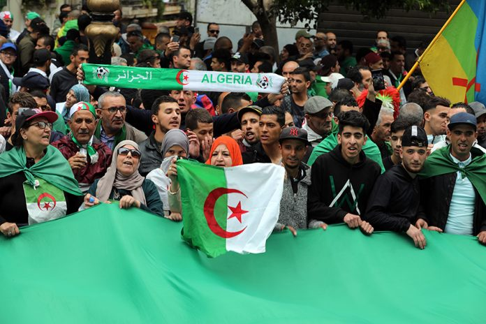 Algerians protest during a demonstration for the departure of the Algerian regime in Algiers, Algeria, 19 April 2019. The Algerian protests that began in early February 2019, after the former president announced his candidacy for a fifth presidential term, continue to call for radical change of the system. EPA/MOHAMED MESSARA
