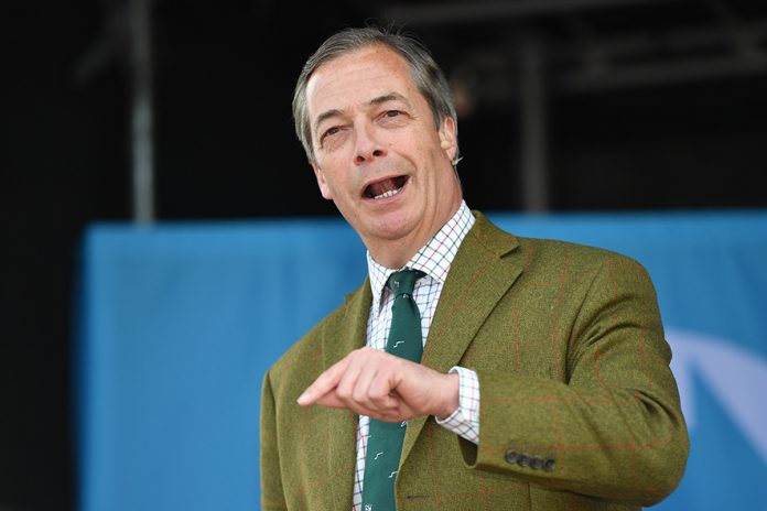 CHESTER, ENGLAND - MAY 06: Nigel Farage speaks on stage at Old Hall Country Club on May 06, 2019 in Chester, United Kingdom. Nigel Farage, the former leader of the U.K. Independence Party, is campaigning for the Brexit Party's contest for this month's European Parliament elections, whose candidates include Annunziata Rees-Mogg. The Brexit Party is reported to be polling in front of Labour and the Conservatives for the European parliament elections. (Photo by Anthony Devlin/Getty Images)