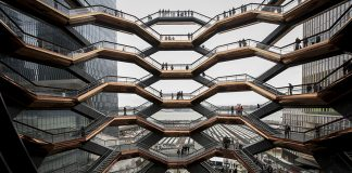 NEW YORK, NY - MARCH 15: Visitors walk through 'The Vessel,' a public art structure consisting of 155 flights o stairs, on the opening day for phase one of the Hudson Yards development on the West Side of Midtown Manhattan on March 15, 2019 in New York City. Four towers, including residential, commercial, and retail space, and a large public art sculpture made up of 155 flights of stairs, called 'The Vessel,' will open to the public. The developer of the project, Related Companies, calls it the most expensive endeavor in the city since Rockefeller Center. (Photo by Drew Angerer/Getty Images)