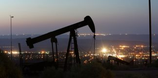 TAFT, CA - JULY 21: An oil rig south of town extracts crude on July 21, 2008 in Taft, California. Hemmed in by the richest oil fields in California, the oil town of 6,700 with a stagnated economy and little room to expand has hatched an ambitious plan to annex vast expanses of land reaching eastward to Interstate 5, 18 miles away, and take over various poor unincorporated communities to triple its population to around 20,000. With the price as light sweet crude at record high prices, Chevron and other companies are scrambling to drill new wells and reopen old wells once considered unprofitable. The renewed profits for oil men of Kern County, where more than 75 percent of all the oil produced in California flows, do not directly translate increased revenue for Taft. The Taft town council wants to cash in on the new oil boom with increased tax revenues from a NASCAR track and future developments near the freeway. In an earlier oil boom era, Taft was the site of the 1910 Lakeside Gusher, the biggest oil gusher ever seen in the US, which destroyed the derrick and sent 100,000 barrels a day into a lake of crude. (Photo by David McNew/Getty Images)