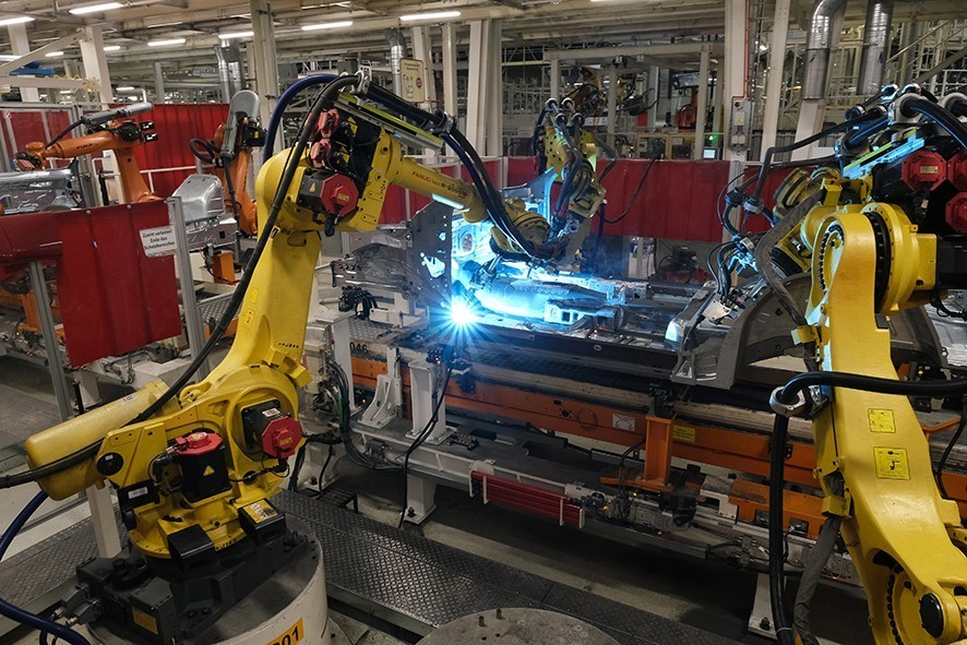WOLFSBURG, GERMANY - MARCH 01: Fanuc robots weld auto bodies at the Volkswagen factory on March 01, 2019 in Wolfsburg, Germany. Volkswagen is scheduled to hold its annual press conference to announce financial results for last year on March 12.(Photo by Sean Gallup/Getty Images)