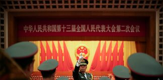 BEIJING, CHINA - MARCH 05: Chinese military conductor gestures as he instructs his music band members during a rehearsal for the opening session of the National People's Congress at the Great Hall of the People on March 5, 2019 in Beijing, China. According to the government work report, the main expected targets for economic and social development this year are: GDP growth of 6%-6.5%, urban employment of more than 11 million, urbanization unemployment rate of 5.5%, and urban registered unemployment rate of 4.5%. The consumer price rose by about 3%, the rural poor population fell by more than 10 million, and the energy consumption per unit of GDP fell by about 3%. (Photo by Lintao Zhang/Getty Images)