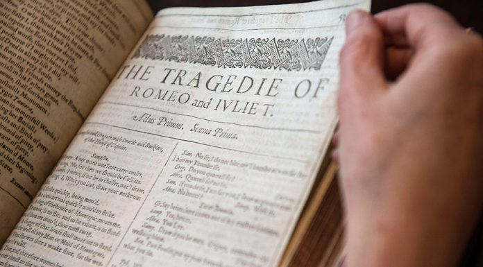 LONDON, ENGLAND - APRIL 19: International Head of Books and Manuscripts, Margaret Ford, handles the first folio of William Shakespeare's work that contains the play 'Romeo and Juliet' during an unveiling for auction at Christie's King Street on April 19, 2016 in London, England. The preview of the sale commemorates 400 years since the death of Shakespeare (1564-1616). The auction will be led by an unrecorded copy of the first folio, the first collected edition of Shakespeare's plays, which contains 36 plays and is estimated at £800,000-£1.2 million.The folios will go on public display in London from 20 to 28 April and then later being put up in a four lot auction on 25 May 2016. The sale is expected to reach in excess of £1.3 million (Photo by Chris Ratcliffe/Getty Images)