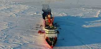 (181216) -- BEIJING, Dec. 16, 2018 (Xinhua) -- Aerial photo taken on Dec. 5, 2018 shows China's research icebreaker Xuelong in Antarctica. China's 35th Antarctic research expedition team finished the first phase of unloading supplies operation on Friday. (Xinhua/Liu Shiping)