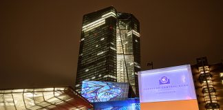 """FRANKFURT AM MAIN, GERMANY - MARCH 16: The headquarters of the European Central Bank (ECB) stands illuminated during a rehearsal for the upcoming Luminale festival on March 16, 2018 in Frankfurt, Germany. The Luminale, whose organizers describe it as a: """"Biennale for Light Art and Urban Design,"""" will illuminate landmarks and buildings in Frankfurt with artistic compositions from March 18-23. (Photo by Thomas Lohnes/Getty Images)"""