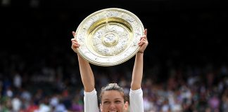 LONDON, ENGLAND - JULY 13: Simona Halep of Romania lifts the trophy after winning the Ladies' Singles final against Serena Williams of The United States during Day twelve of The Championships - Wimbledon 2019 at All England Lawn Tennis and Croquet Club on July 13, 2019 in London, England. (Photo by Shaun Botterill/Getty Images)