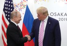 epa07679049 Russian President Vladimir Putin (L) shakes hands with US President Donald J. Trump (R) during their meeting on the sidelines of the G20 leaders summit in Osaka, Japan, 28 June 2019. The summit gathers leaders from 19 countries and the European Union to discuss topics such as global economy, trade and investment, innovation and employment. EPA/MICHAEL KLIMENTYEV/SPUTNIK/KREMLIN POOL