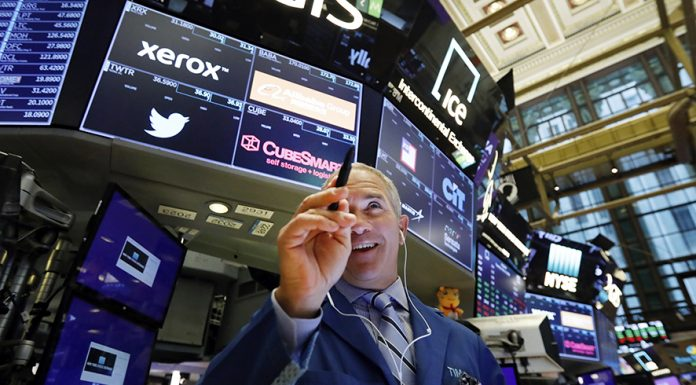 Trader Timothy Nick works on the floor of the New York Stock Exchange, Tuesday, May 14, 2019. Stocks are opening broadly higher on Wall Street as the market claws back some of the ground it lost in a big slide a day earlier. (AP Photo/Richard Drew)