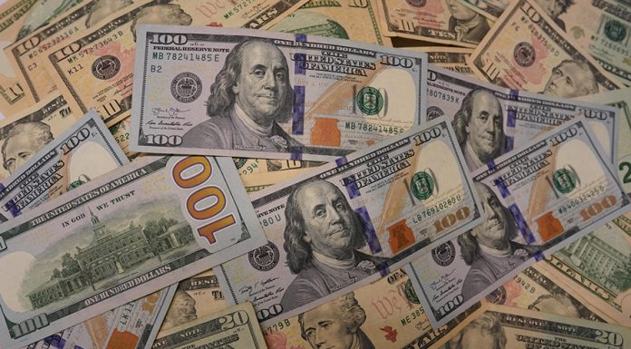 (190801) -- WASHINGTON, Aug. 1, 2019 (Xinhua) -- Photo taken on July 31, 2019 shows U.S. dollar banknotes in Washington D.C., the United States. U.S. Federal Reserve on Wednesday lowered interest rates for the first time since the 2008 global financial crisis, amid rising concerns over trade tensions, a slowing global economy and muted inflation pressures. The Federal Open Market Committee, the Fed's rate-setting body, trimmed the target for the federal funds rate by 25 basis points to a range of 2 percent to 2.25 percent after concluding its two-day policy meeting, in line with market expectation. (Xinhua/Liu Jie)