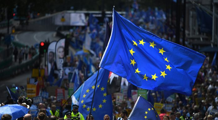 "LONDON, ENGLAND - JULY 20: Protesters holding a European flag march to Parliament Square in Westminster during the ""No To Boris, Yes To Europe"" March on July 20, 2019 in London, England. Anti-Brexit campaigners gathered to march through central London today with the message ""say no to Boris and yes to Europe"" and demand an end to Brexit. The march comes just days ahead of Boris Johnson's widely expected win to become Prime Minister in the Conservative Leadership Campaign. (Photo by Chris J Ratcliffe/Getty Images)"