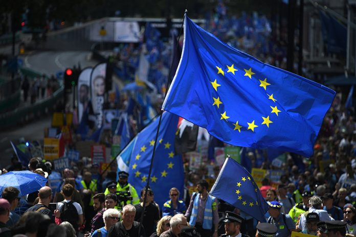 LONDON, ENGLAND - JULY 20: Protesters holding a European flag march to Parliament Square in Westminster during the