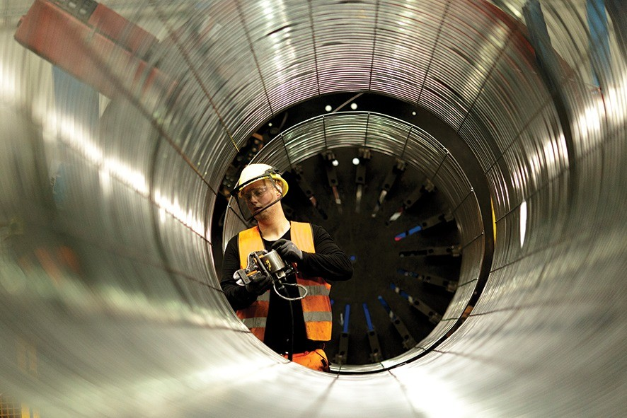 SASSNITZ, GERMANY - OCTOBER 19: An employee works on an iron cage the production process of pipes in the production hall at the Nord Stream 2 facility at Mukran on Ruegen Islandon October 19, 2017 in Sassnitz, Germany. Nord Stream is laying a second pair of offshore pipelines in the Baltic Sea between Vyborg in Russia and Greifswald in Germany for the transportation of Russian natural gas to western Europe. An initial pair of pipelines was inaugurated in 2012 and the second pair is due for completion by 2019. A total of 50,000 pipes are currently on hand at Mukran, where they receive a concrete wrapping before being transported out to sea. Russian energy supplier Gazprom, whose board is led by former German chancellor Gerhard Schroeder, owns a 51% stake in Nord Stream. (Photo by Carsten Koall/Getty Images)