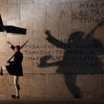 ATHENS, GREECE - JANUARY 21: Greek Presidential Guard soldiers perform their duties in front of the the Greek Tomb of the Unknown Soldier beneath the Hellenic Parliament which is home to the Greek parliament ahead of this weekend general election on January 21, 2015 in Athens, Greece. According to the latest opinion polls, the left-wing Syriza party are poised to defeat Prime Minister Antonis Samaras' conservative New Democracy party in the election, which will take place on Sunday. European leaders fear that Greece could abandon the Euro, write off some of its national debt and put an end to the country's austerity by renogotiating the terms of its bailout if the radical Syriza party comes to power. Greece's potential withdrawal from the eurozone has become known as the 'Grexit'. (Photo by Matt Cardy/Getty Images)