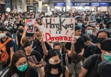 "HONG KONG, CHINA - AUGUST 12: Protesters occupy the arrival hall of the Hong Kong International Airport during a demonstration on August 12, 2019 in Hong Kong, China. Pro-democracy protesters have continued rallies on the streets of Hong Kong against a controversial extradition bill since 9 June as the city plunged into crisis after waves of demonstrations and several violent clashes. Hong Kong's Chief Executive Carrie Lam apologized for introducing the bill and declared it ""dead"", however protesters have continued to draw large crowds with demands for Lam's resignation and completely withdraw the bill. (Photo by Anthony Kwan/Getty Images)"