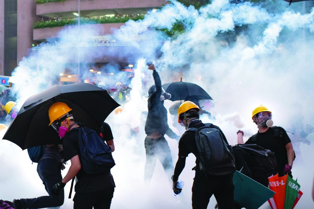 """HONG KONG, CHINA - [AUGUST 5]: Protesters stand off against riot police at Wong Tai Sin district on August 05, 2019 in Hong Kong, China. Pro-democracy protesters have continued rallies against a controversial extradition bill on the streets of Hong Kong since June 9th, as the city plunged into crisis after waves of demonstrations and several violent clashes. Hong Kong's Chief Executive Carrie Lam apologized for introducing the bill and declared it """"dead"""", however protesters have continued to draw large crowds with demands for Lam's resignation and the complete withdrawal of the bill. (Photo by Billy H.C. Kwok/Getty Images)"""