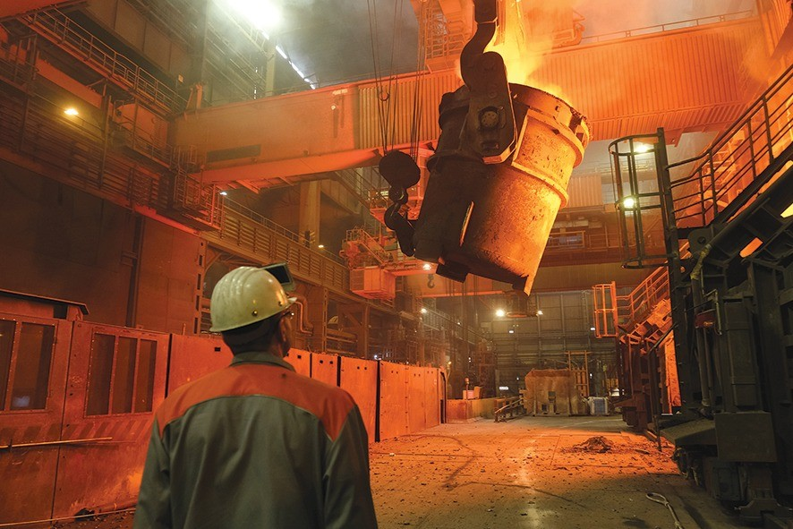 SALZGITTER, GERMANY - MARCH 05: A worker watches as a ladle recedes after pouring molten iron into a converter for creating steel at the Salzgitter AG steelworks on March 05, 2019 in Salzgitter, Germany. Salzgitter produces a wide variety of steel products, including galvanized flat steel used for cars and appliances.  (Photo by Sean Gallup/Getty Images)