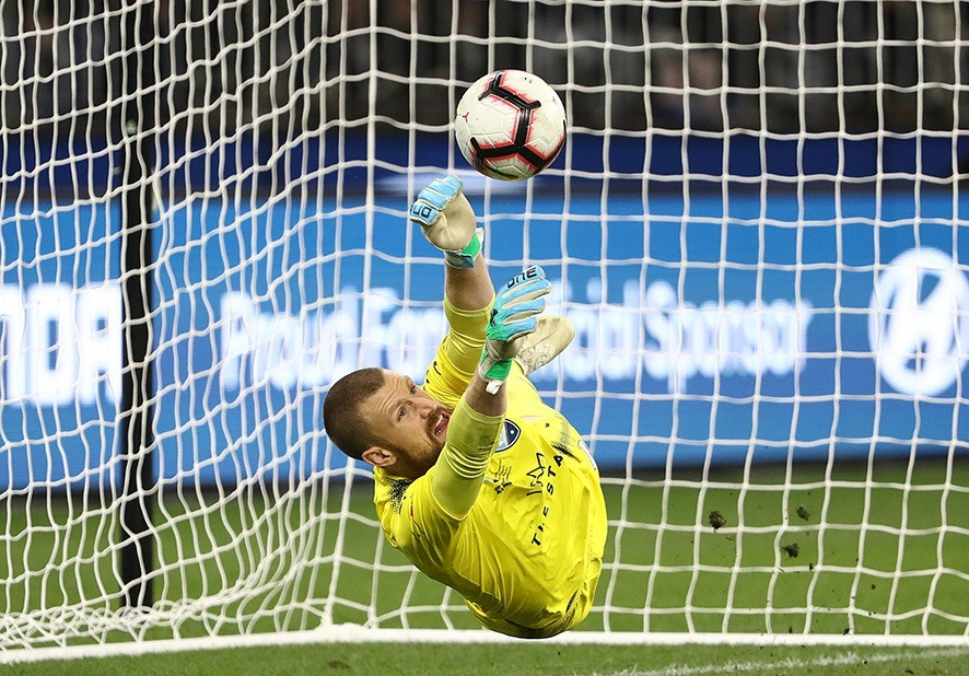 PERTH, AUSTRALIA - MAY 19: Sydney FC goalkeeper Andrew Redmayne makes a save to deny Andy Keogh of Perth Glory in the penalty shoot out during the 2019 A-League Grand Final match between the Perth Glory and Sydney FC at Optus Stadium on May 19, 2019 in Perth, Australia. (Photo by Robert Cianflone/Getty Images)