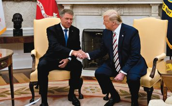 epa07782917 U.S. President Donald Trump (R) shakes hands with Klaus Iohannis, Romania's president, in the Oval Office of the White House in Washington, D.C., USA, 20 August 2019. Trump said today he's 'not ready to make a deal with China,' but adds Beijing wants an agreement and something could happen soon. EPA/Andrew Harrer / POOL