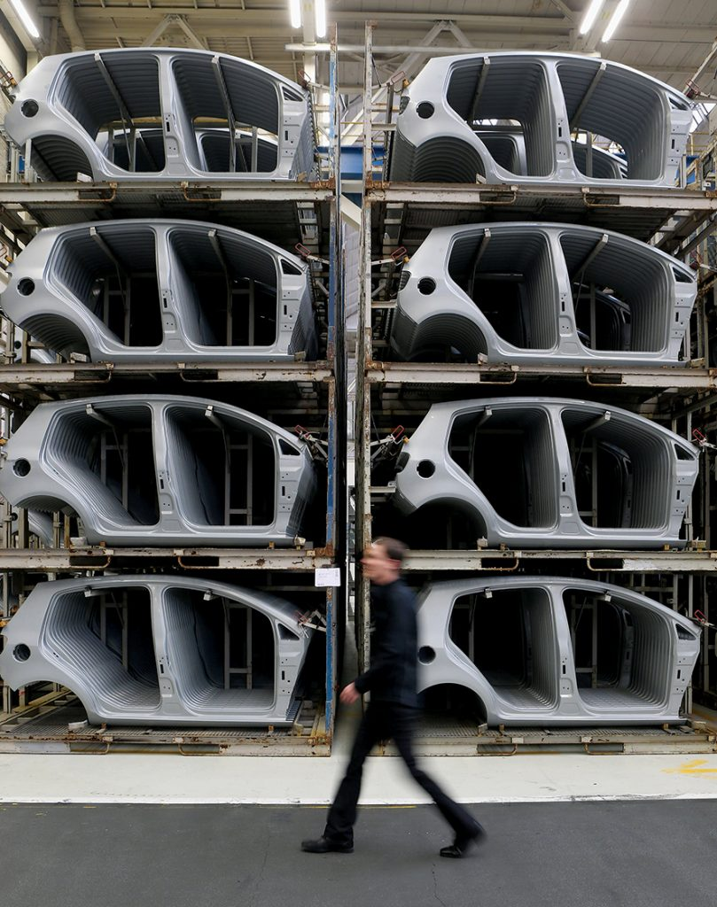 WOLFSBURG, GERMANY - FEBRUARY 25: A Volkswagen employee, at the request of the photographer, walks past stacked stamped car body parts for new VW Golf VII and Tiguan cars at the Volkswagen factory on February 25, 2013 in Wolfsburg, Germany. Volkswagen will announce financial results for 2012 on March 14. (Photo by Sean Gallup/Getty Images)