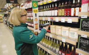 ROCHDALE, ENGLAND - JANUARY 23: A member of staff scans groceries inside Rochdale's Morrisons supermarket on January 23, 2017 in Rochdale, England. Wm Morrison Supermarkets Plc has over 500 stores in the UK and operates an online home delivery service. Morrisons recently had its best Christmas for seven years after the supermarket chain revamped its premium ranges. (Photo by Christopher Furlong/Getty Images)