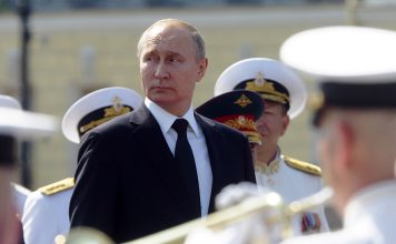 Russian President Vladimir Putin (C) attends the military parade during the Navy Day celebration in St.Petersburg, Russia, 28 July 2019. EPA/DMITRY LOVETSKY POOL PHOTO