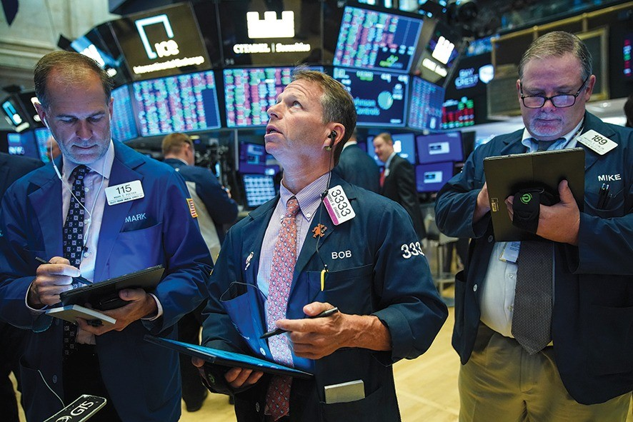 NEW YORK, NY - AUGUST 13: Traders and financial professionals work on the floor of the New York Stock Exchange (NYSE) at the opening bell on August 13, 2019 in New York City. The Dow Jones Industrial Average jumped up 400 points in early trading on Tuesday, led by Apple after the Trump administration said it will delay tariffs on some items, initially set to go into effect on September 1, until December 15. (Photo by Drew Angerer/Getty Images)